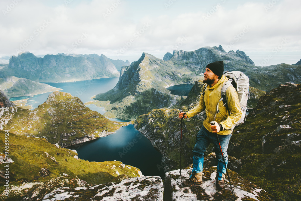 Fototapety, obrazy: Bearded man traveler standing on cliff mountain in Norway Traveling with backpack healthy lifestyle adventure concept hiking active summer vacations outdoor
