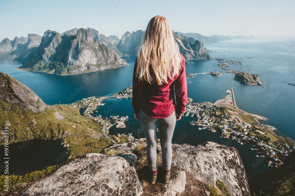 Fototapety, obrazy: Young blonde woman standing alone on cliff mountain travel lifestyle exploring concept adventure outdoor summer vacations in Norway
