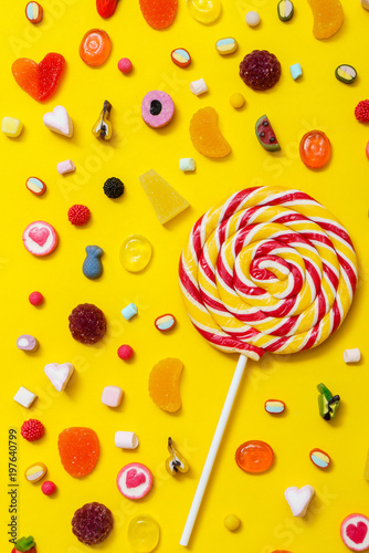 Poster Confiserie colorful candy on the yellow background