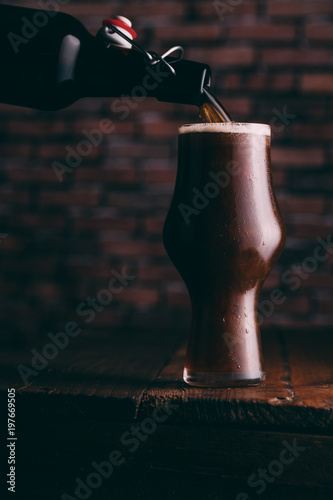 Spoed Foto op Canvas Bier / Cider Serving stout beer in glass on dark background