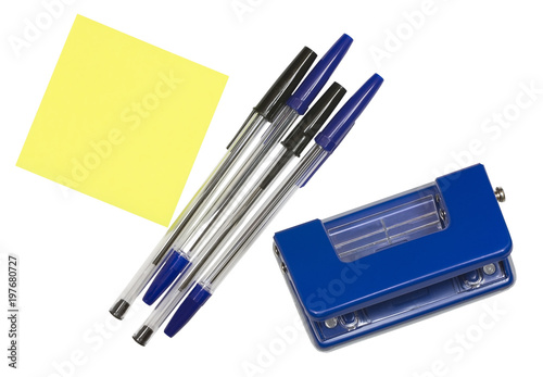 Fotografia, Obraz  Office tools hole punch, note paper and pen isolated on white