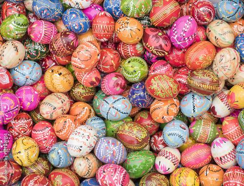 Fotografie, Obraz  Basket full of traditional Polish, multi-colored, handpainted wooden Easter eggs