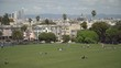 People lying on grass in Dolores Park