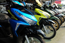 Many Colorful Motorcycles At The Showroom For Sale