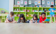 canvas print picture Group of diversity kid lay down on floor and reading tale book in preschool library,Kindergarten school education concept