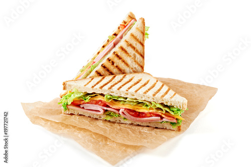 Staande foto Snack Sandwich with ham, cheese, tomatoes, lettuce, and toasted bread. Above view isolated on white background.