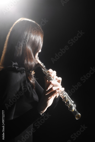 Photo sur Toile Musique Flute player. Flutist playing flute music instrument