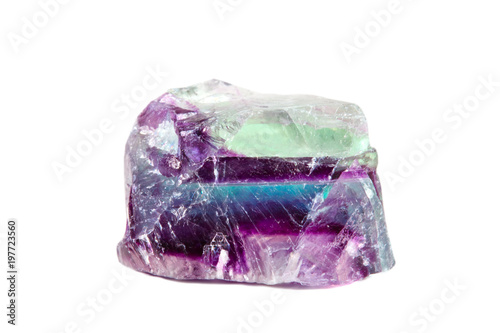 Macro shooting of natural gemstone. Raw mineral fluorite, Brazil. Isolated object on a white background.