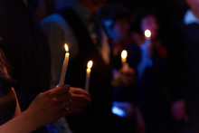 People Hold Candles Light At D...