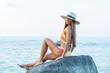 beautiful young woman fashion model in bikini on the beach