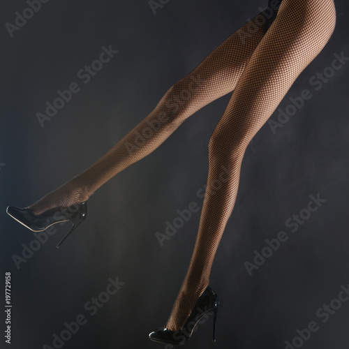 4875a807b Long Woman Legs isolated on black studio background. Depilation. Beautiful  legs woman with high heels shoes. Young beautiful woman in underwear with  sexy ...