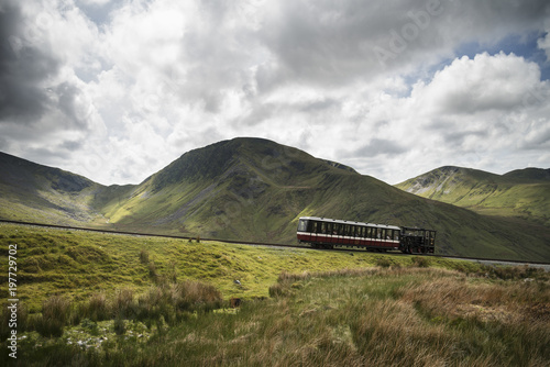 Photo Snowdon Mountain Railway making it's way up to Snowdon with Moel Cynghorion in b