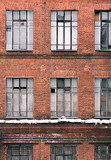 Winter facade of an old brick building in loft style. High Windows and textural materials - 197743399