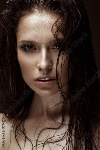 Fototapeta  Beautiful girl with a bright make-up and wet hair and skin