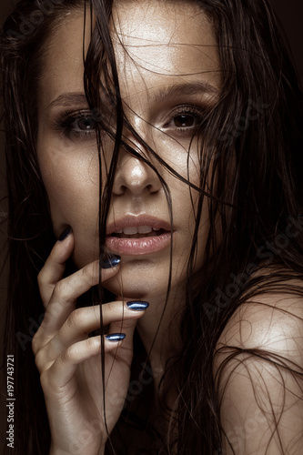 Fotografie, Obraz  Beautiful girl with a bright make-up and wet hair and skin