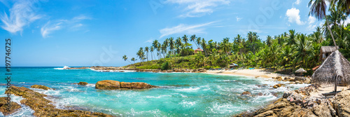 Foto op Plexiglas Strand Panoramic view of a small lagoon with traditional wooden fishing boats and old bungalow on the beach in Sri Lanka.