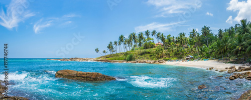 Fotografía Panoramic view of a small lagoon with traditional wooden fishing boats on the beach in Sri Lanka