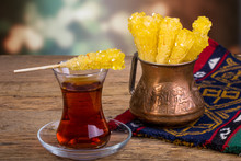 Close Up Of Saffron Rock Candy Sugar Crystal On A Black Tea Cup Is Often Used To Be Dissolved In Tea In Iranian Persian Cuisine