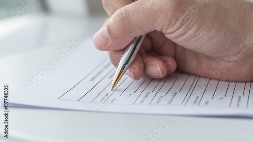 Applicant filling in company application form document applying for job, or regi Canvas Print