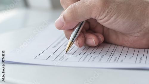 Fotomural Applicant filling in company application form document applying for job, or regi