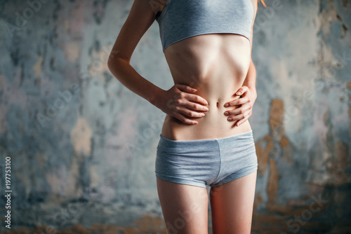Photo Female with slim waist, weight loss, anorexia