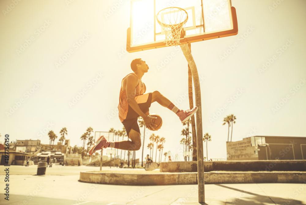 Basketball slam dunk on a californian court