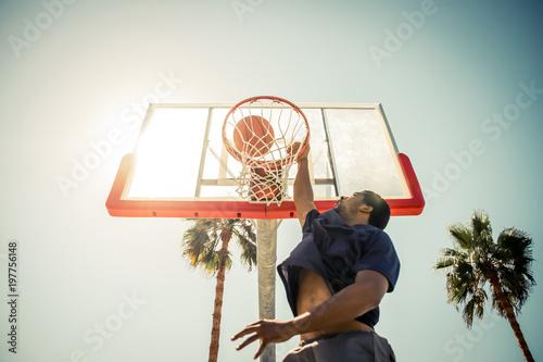 Basketball slam dunk on a californian court Canvas Print