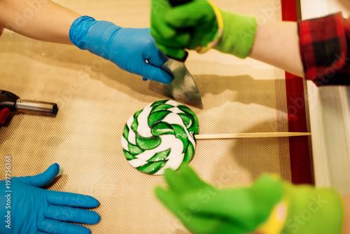 Foto op Aluminium Snoepjes Lollipop preparation process, child makes caramel
