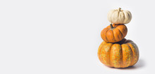 Stack Of Ripe Pumpkins On Whit...