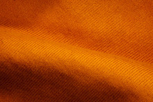 Texture Of A Orange Fabric Bac...