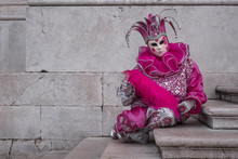 Woman Dressed Up As Jester In Pink Costume At The Venice Carnival (Carnivale Di Venezia)