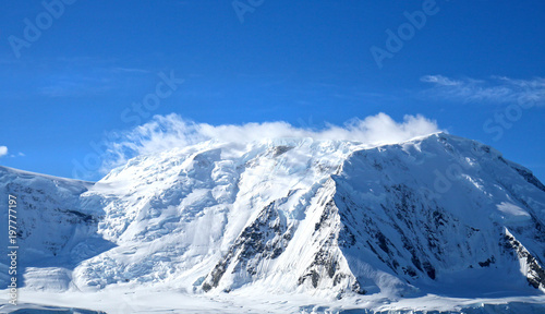 Foto op Canvas Antarctica Antarctic ocean, Antarctica. Glacier Snow Covered Mountain. Dramatic blue Sky background