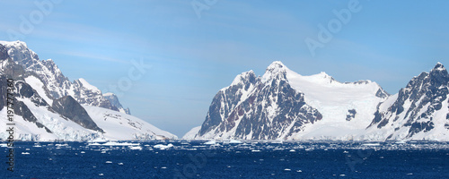Staande foto Antarctica Antarctic ocean, Antarctica. Glacier Snow Covered Mountain. Dramatic blue Sky background. Two Photo Pano stitch.