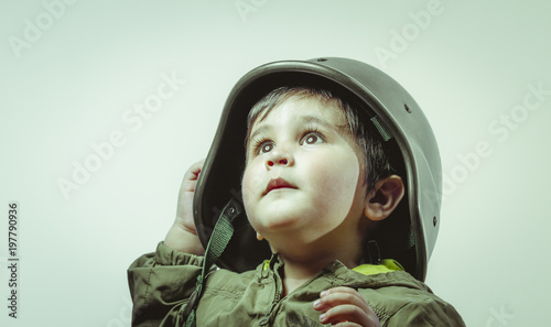 Cute little toddler boy, playing at home with playing wars and peace,funny child Canvas Print