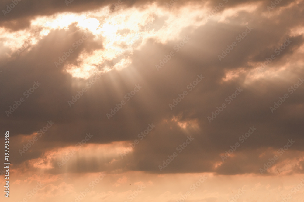 Fototapeta dramatic sky sunset, sun through the clouds sunlight