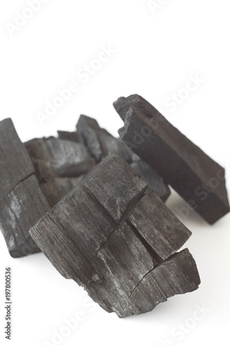 Photo  wood charcoal isolated on white background.