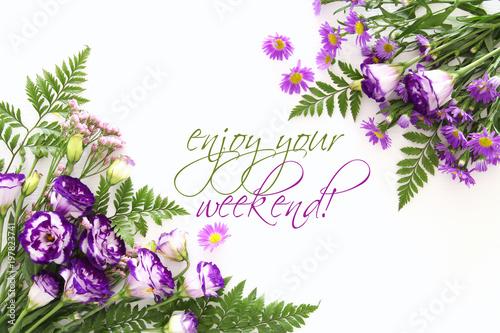 Foto op Canvas Lavendel Top view of purple beautiful flowers arrangement on white wooden background.
