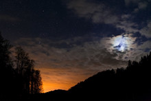 Night Sky Full Of Stars With Waxing Crescent Of Moon And Sunset Under Them