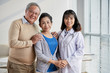 Asian Doctor with Senior Patients