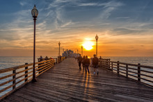 People Walking On Oceanside Pier At Sunse, California