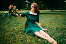 Young Happy Red Haired Girl Wi...