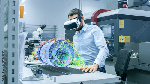 Photo  Factory Chief Engineer Wearing VR Headset Designs Engine Turbine on the Holographic Projection Table