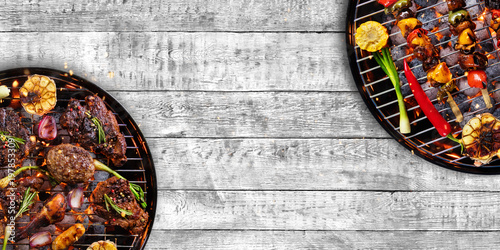 Aluminium Prints Grill / Barbecue Top view of fresh meat and vegetable on grill placed on wood