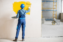 Workman In Uniform Painting Wa...