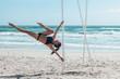 Pole dancer on the beach