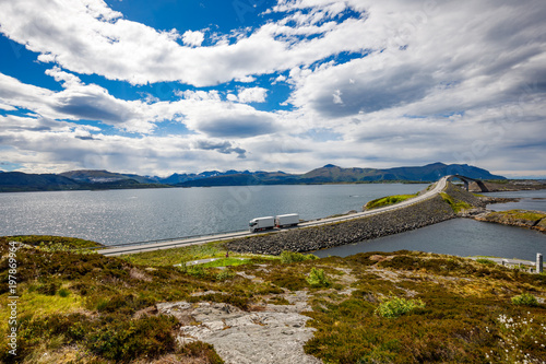 Fotografia  Truck rushes down the highway in the background Atlantic Ocean Road Norway
