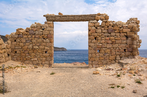 Foto op Plexiglas Rudnes The ruins of an ancient building in the picturesque village of Firopotamos on Milos Island. Cyclades, Greece.