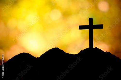 The Cross Standing On Hill Sunset And Bokeh Backgroundoss On A