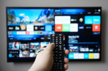 Male Hand Holding TV Remote Control. Smart TV.