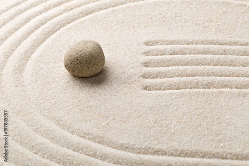 Zen sand and stone garden with raked lines and curves. Simplicity, concentration or calmness abstract concept